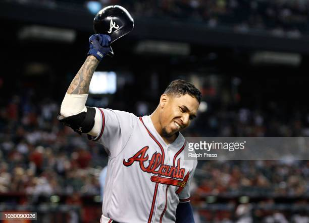Johan Camargo of the Atlanta Braves tips his helmet to the crowd after hitting a tworun home run against the Arizona Diamondbacks during the ninth...