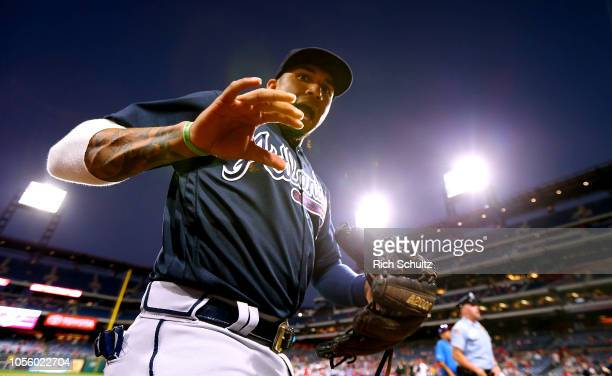 Johan Camargo of the Atlanta Braves walks off the field before a game against the Philadelphia Phillies at Citizens Bank Park on September 28 2018 in...