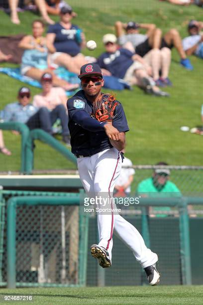 Johan Camargo of the Braves makes the off balance throw over to first base for the out during the spring training game between the Washington...