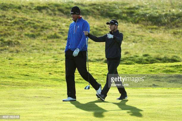 Johan Carlsson of Sweden and Austin Connelly of The United States walk down the 3rd during day two of the 2017 Alfred Dunhill Championship at...