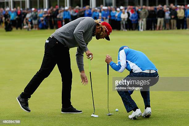 Johan Carlsson of Sweden and Daniel Brooks of England talk about ball placement on the 18th green during the third round of the Aberdeen Asset...