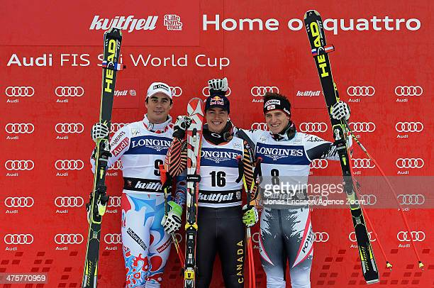 Johan Clarey of France takes 2nd place, Matthias Mayer of Austria takes 3rd place, Erik Guay of Canada takes 1st place during the Audi FIS Alpine Ski...