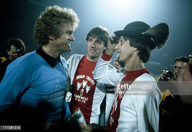 Johan Cruyff Testimonial Football Ajax v Bayern Munich Johan Cruyff receives a Bavarian hat from Sepp Maier ahead of his testimonial match