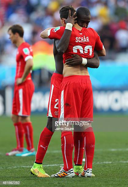 Johan Djourou and Fabian Schar of Switzerland react after being defeated by Argentina 10 in extra time during the 2014 FIFA World Cup Brazil Round of...