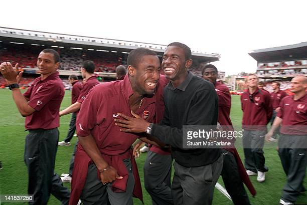 Johan Djourou and Fabrice Muamba of Arsenal on the pitch during a parade to mark the last game played at the Arsenal Stadium in Highbury on May 7...