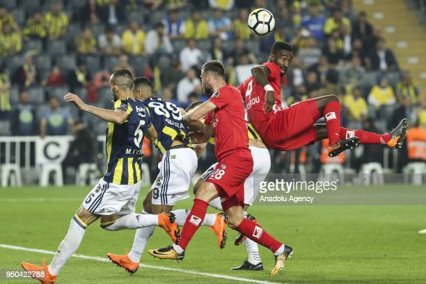 Johan Djourou and Ondrej Celustka of Antalyaspor in action against Josef de Souza and Mehmet Topal of Fenerbahce Turkish Super Lig soccer match...