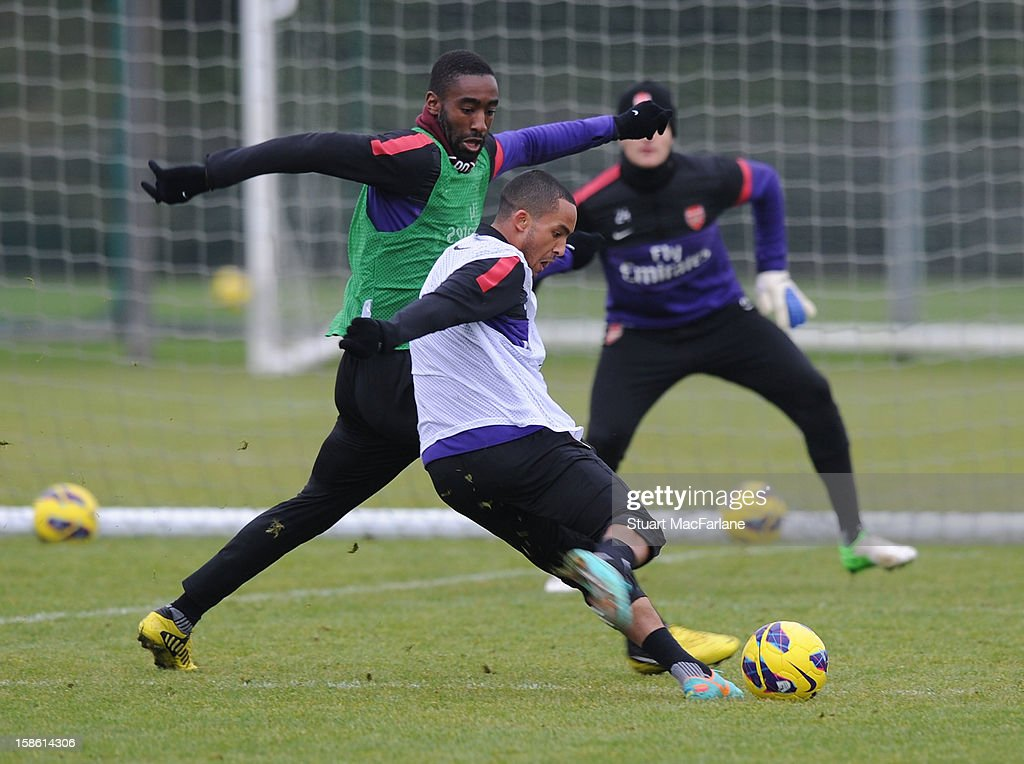 Johan Djourou and Theo Walcott of Arsenal during a training session at London Colney on December 21, 2012 in St Albans, England.