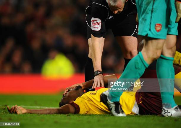 Johan Djourou of Arsenal lies on the pitch in pain after disclocating his shoulder during the FA Cup sponsored by EOn Sixth Round match between...