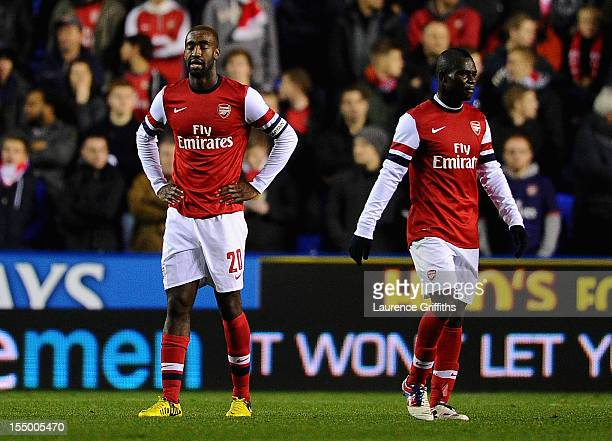 Johan Djourou of Arsenal shows his despair in front of Emanuel Frimpong after the fourth goal during the Capital One Cup Fourth Round match between...