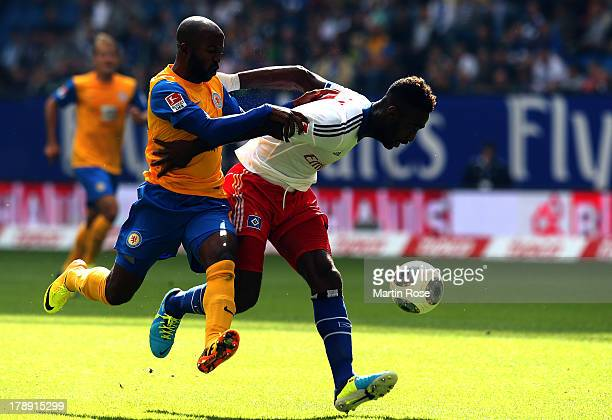 Johan Djourou of Hamburg and Domi Kumbela of Braunschweig battle for the ball during the Bundesliga match between Hamburger SV and Eintracht...