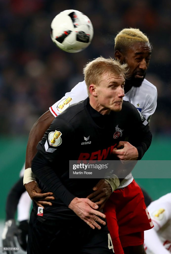 Johan Djourou (back) of Hamburg and Dominique Klein of Koeln head for the ball during the DFB Cup round of 16 match between Hamburger SV and 1. FC Koeln at Volksparkstadion on February 7, 2017 in Hamburg, Germany.