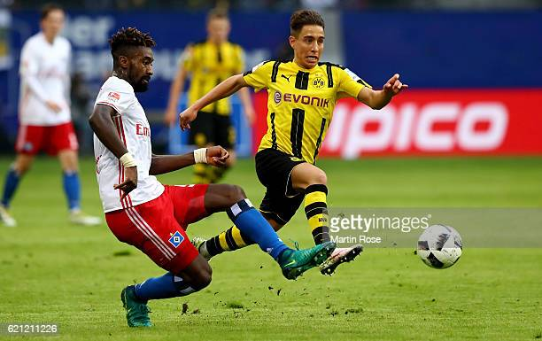 Johan Djourou of Hamburg and Emre Mor of Dortmund battle for the ball during the Bundesliga match between Hamburger SV and Borussia Dortmund at...