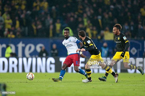 Johan Djourou of Hamburg and Gonzalo Castro of Dortmund compete for the ball during the First Bundesliga match between Hamburger SV and Borussia...