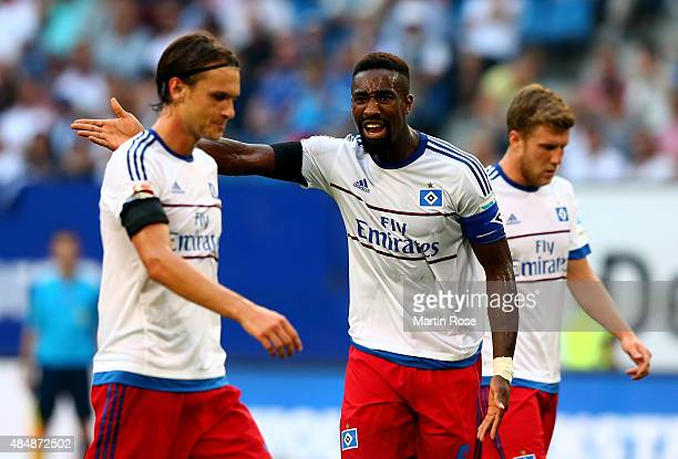 Johan Djourou of Hamburg argues with tteam mate Albin Ekdal during the Bundesliga match between Hamburger SV and VfB Stuttgart at Volksparkstadion on...