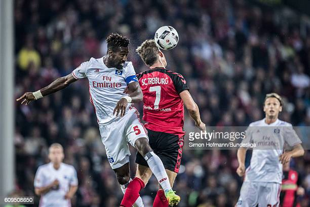 Johan Djourou of Hamburg jumps for a header with Florian Niederlechner of Freiburg during the Bundesliga match between SC Freiburg and Hamburger SV...
