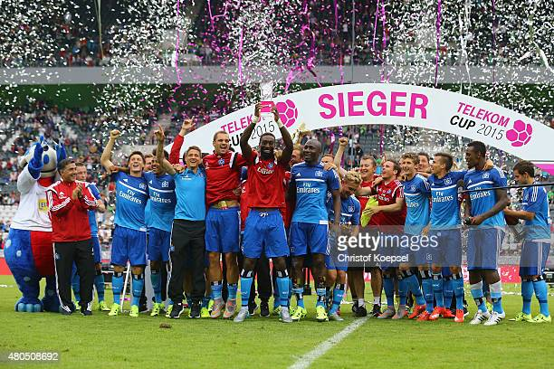 Johan Djourou of Hamburg lifts the winning trophy after winning 21 the Telekom Cup 2015 final match between Hambruger SV and FC Augsburg at...