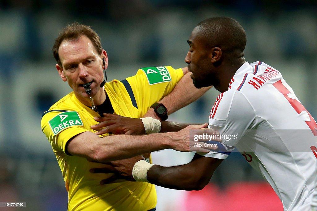 Johan Djourou of Hamburg reacts with referee Florian Meyer during the Bundesliga match between Eintracht Frankfurt and Hamburger SV at Commerzbank-Arena on February 28, 2015 in Frankfurt am Main, Germany.
