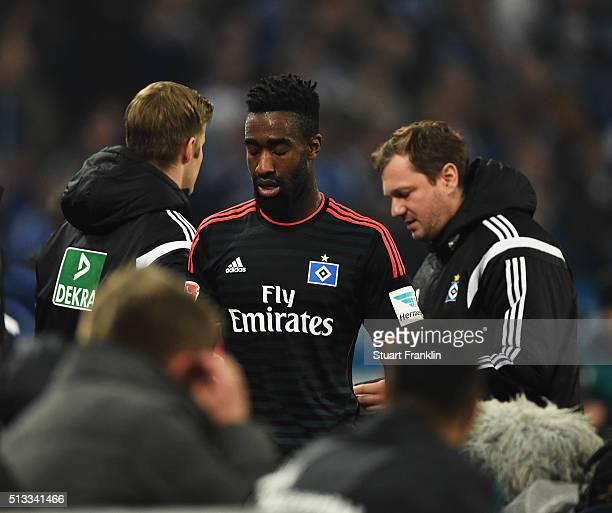 Johan Djourou of Hamburg walks off having been shown the red card during the Bundesliga match between FC Schalke 04 and Hamburger SV at VeltinsArena...
