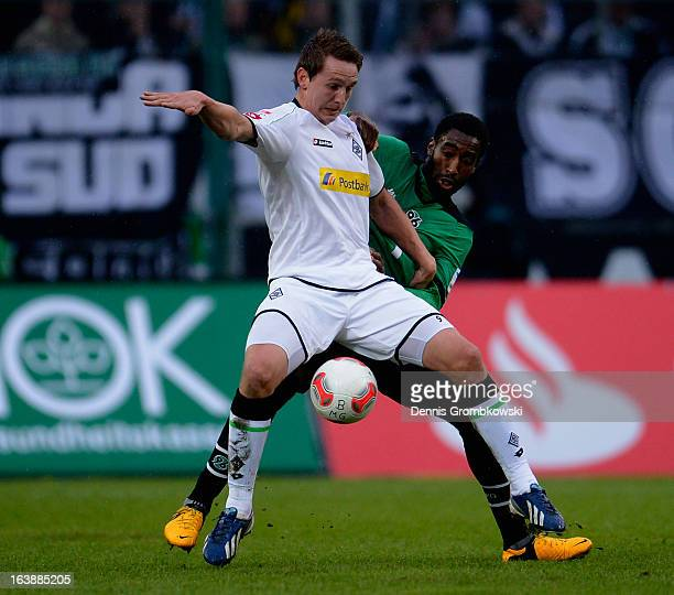 Johan Djourou of Hannover challenges Luuk de Jong of Moenchengladbach during the Bundesliga match between VfL Borussia Moenchengladbach and Hannover...