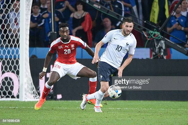 Johan Djourou of Switzerland and Andre Pierre Gignac of France during the UEFA EURO 2016 Group A match between Switzerland and France at Stade...
