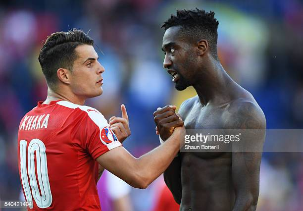Johan Djourou of Switzerland and Granit Xhaka of Switzerland in conversation during the UEFA EURO 2016 Group A match between Romania and Switzerland...