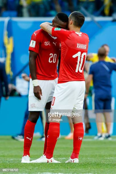Johan Djourou of Switzerland and Granit Xhaka of Switzerland look dejected after the 2018 FIFA World Cup Russia Round of 16 match between Sweden and...