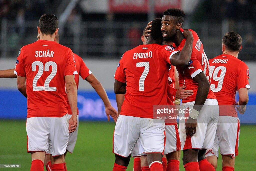 Johan Djourou (R) of Switzerland celebrates with Breel Embolo scoring the fourth goal during the UEFA EURO 2016 qualifier between Switzerland and San Marino at AFG Arena on October 9, 2015 in St Gallen, Switzerland.