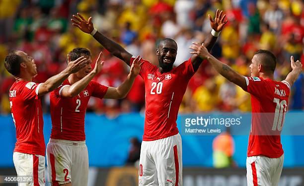 Johan Djourou of Switzerland celebrates with Steve von Bergen Stephan Lichtsteiner and Granit Xhaka after defeating Ecuador 21 in the 2014 FIFA World...