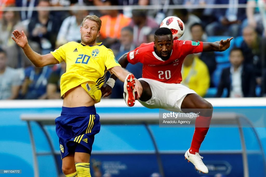 Johan Djourou (R) of Switzerland in action against Ola Toivonen of Sweden during the 2018 FIFA World Cup Russia Round of 16 match between Sweden and Switzerland at the Saint Petersburg Stadium in Saint Petersburg, Russia on July 03, 2018.