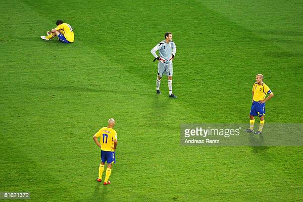 Johan Elmander Henrik Larsson goalkeeper Andreas Isaksson and Fredrik Ljungberg of Sweden look dejected after defeat in during the UEFA EURO 2008...