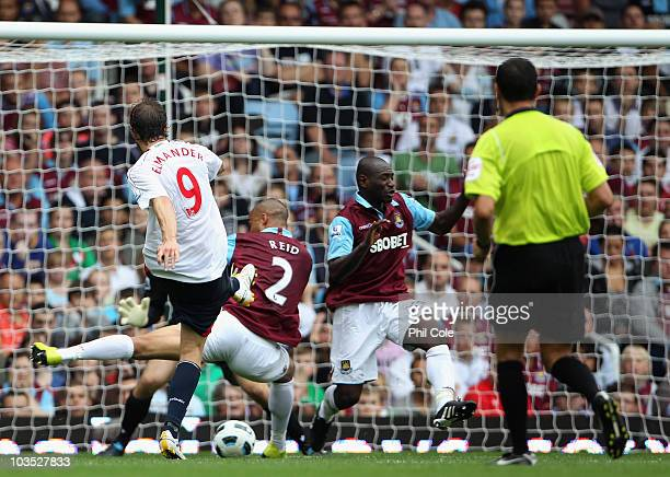 Johan Elmander of Bolton Wanderers scores his second goal and his team's third during the Barclays Premier League match between West Ham United and...