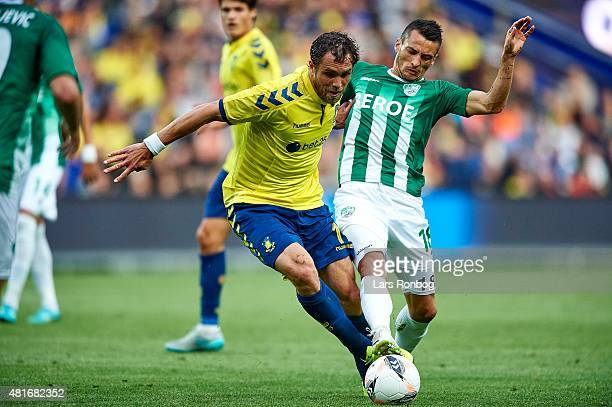 Johan Elmander of Brondby IF and Atanas Zehirov of PFC Beroe Stara Zagora compete for the ball during the UEFA Europa League Qualification match...