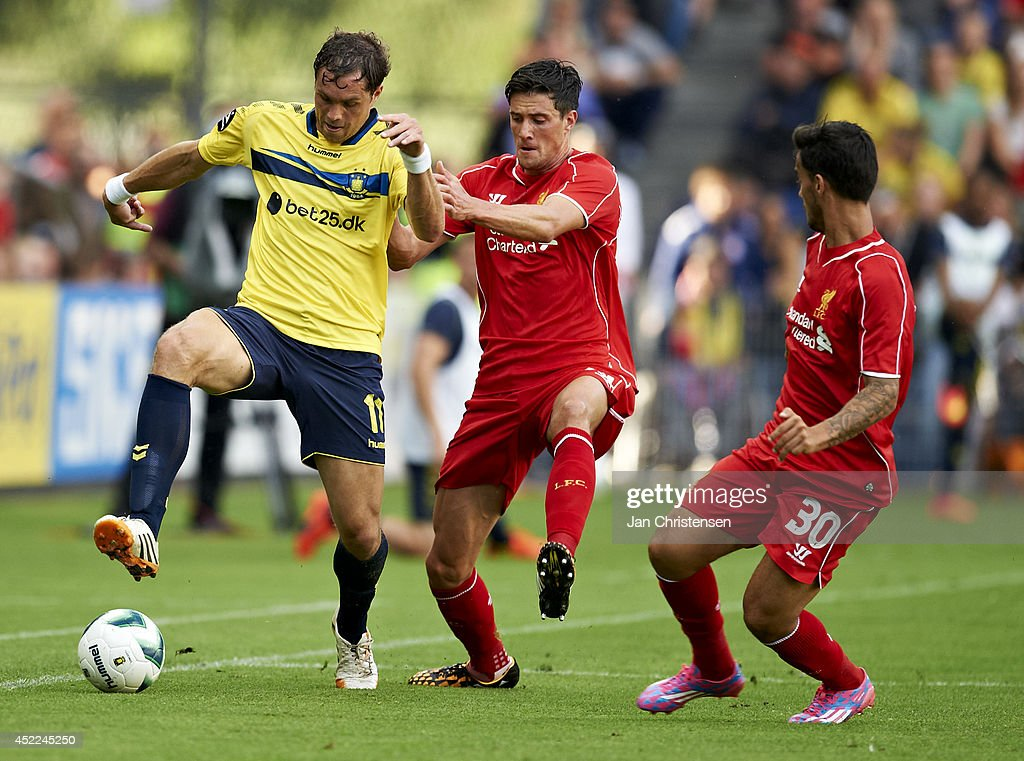 Johan Elmander of Brondby IF (L), Martin Kelly of Liverpool FC and Suso of Liverpool FC compete for the ball during the Pre-Season Friendly match between Brondby IF and Liverpool FC at Brondby stadium on July 16, 2014 in Brondby, Denmark.