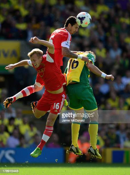 Johan Elmander of Norwich City battles with Jose Fonte and James WardProwse of Southampton during the Barclays Premier League match between Norwich...