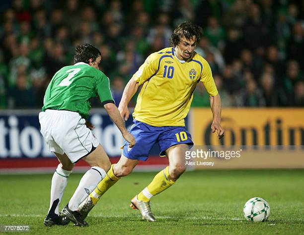 Johan Elmander of Sweden is watched by Michael Duff of Northern Ireland during the Euro2008 Group F Qualifying match between Northern Ireland and...
