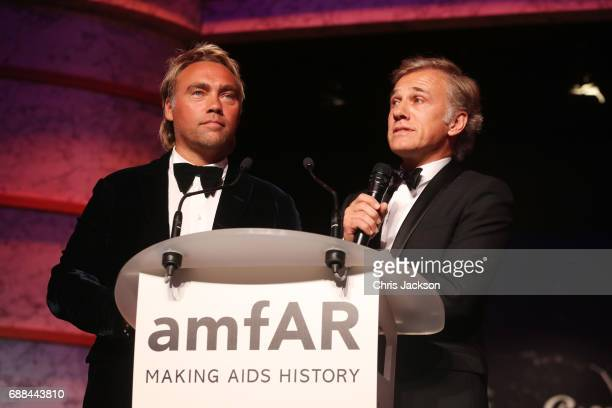Johan Ernst Nilson and Christoph Waltz on stage at the amfAR Gala Cannes 2017 at Hotel du CapEdenRoc on May 25 2017 in Cap d'Antibes France
