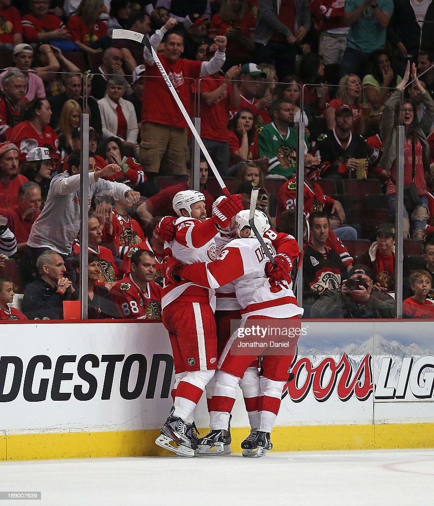 Johan Franzen #93, Justin Abdelkader #8 and Pavel Datsyuk #13 of the Detroit Red Wings celebrate Franzens' third period goal against the Chicago Blackhawks in Game Two of the Western Conference Semifinals during the 2013 NHL Stanley Cup Playoffs at the United Center on May 18, 2013 in Chicago, Illinois. The Red Wings defeated the Blackhawks 4-1.
