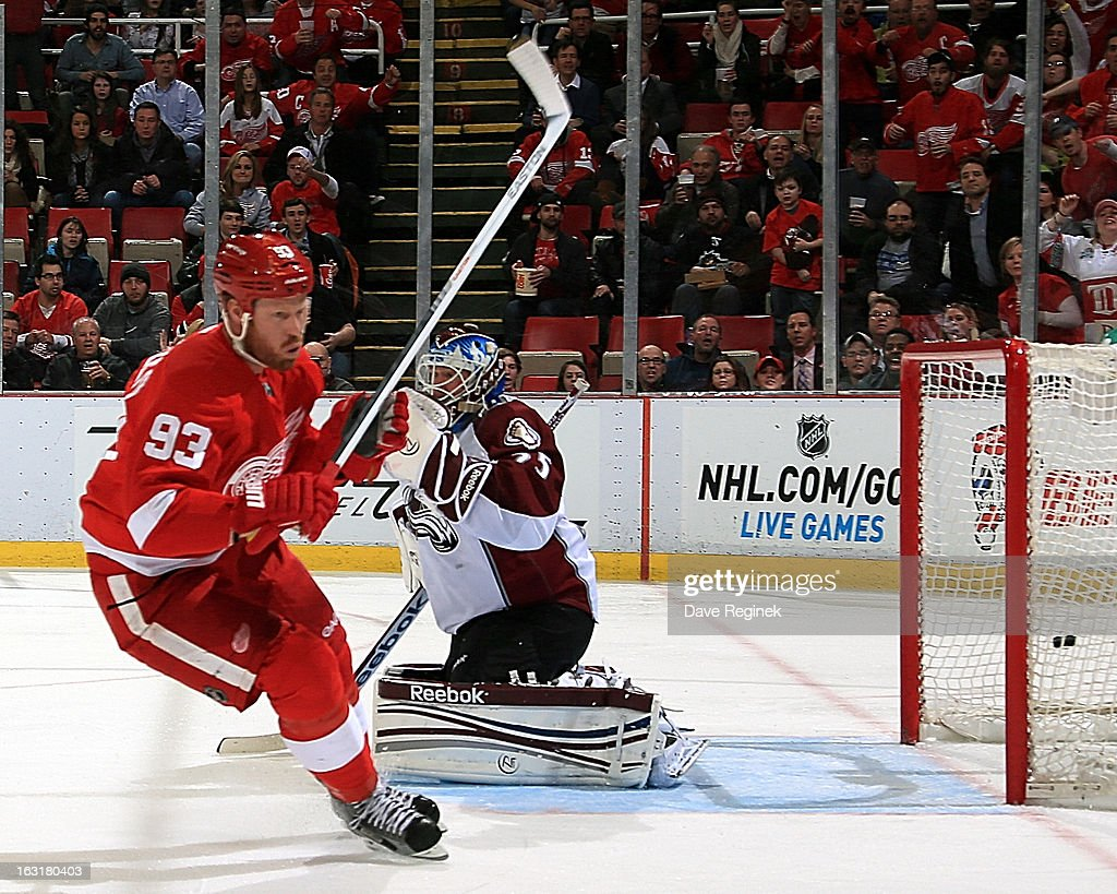 Johan Franzen #93 of the Detroit Red Wings scores a second period goal on Jean-Sebastian Giguere #35 of the Colorado Avalanche during a NHL game at Joe Louis Arena on March 5, 2013 in Detroit, Michigan. The Wings won 2-1