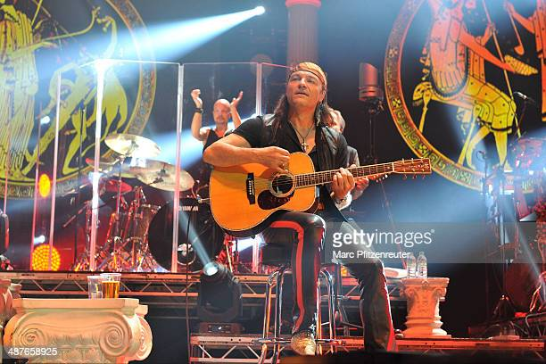 Johan Franzon and Guitarist Matthias Jabs of German heavy metal band Scorpions perform during their 'MTV Unplugged Tour' at the Lanxess Arena on May...