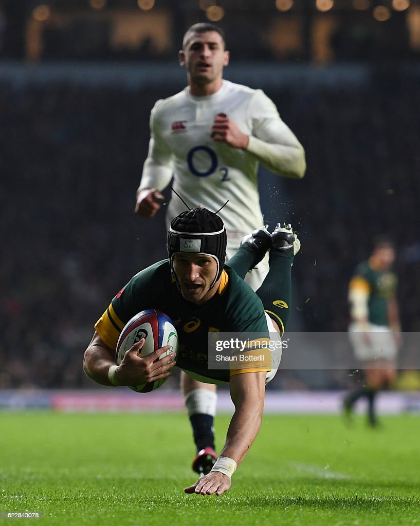 Johan Goosen of South Africa dives to score his team's first try during the Old Mutual Wealth Series match between England and South Africa at Twickenham Stadium on November 12, 2016 in London, England.