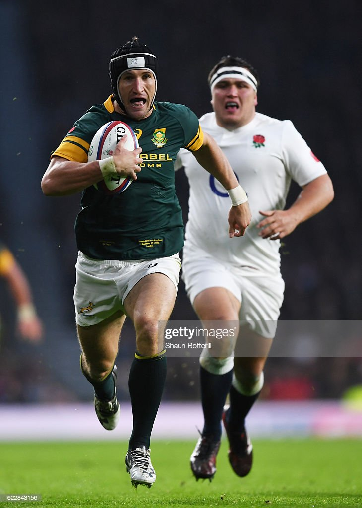 Johan Goosen of South Africa runs with the ball to score his team's first try during the Old Mutual Wealth Series match between England and South Africa at Twickenham Stadium on November 12, 2016 in London, England.