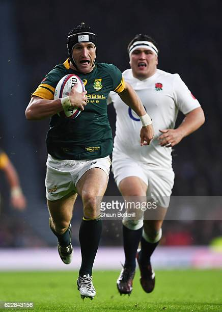 Johan Goosen of South Africa runs with the ball to score his team's first try during the Old Mutual Wealth Series match between England and South...