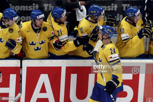 Johan Harju of Sweden celebrates his team's third goal with team mates during the IIHF World Championship group C match between Sweden and France at...