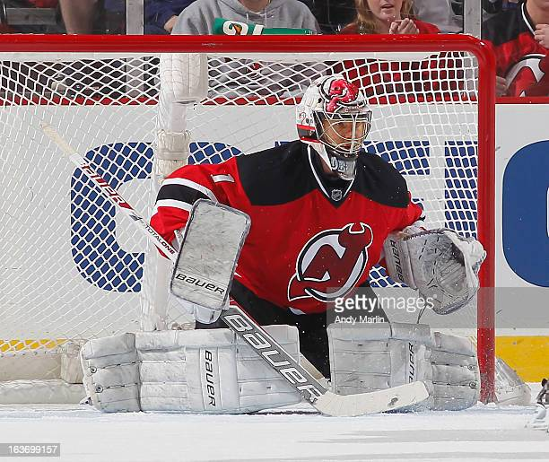 Johan Hedberg of the New Jersey Devils defends his net against the Philadelphia Flyers during the game at the Prudential Center on March 13 2013 in...