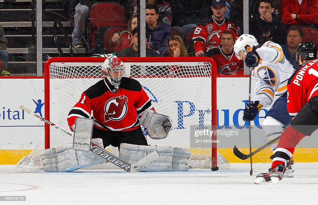 Johan Hedberg #1 of the New Jersey Devils defends his net in the second period against the Buffalo Sabres at the Prudential Center on March 7, 2013 in Newark, New Jersey.