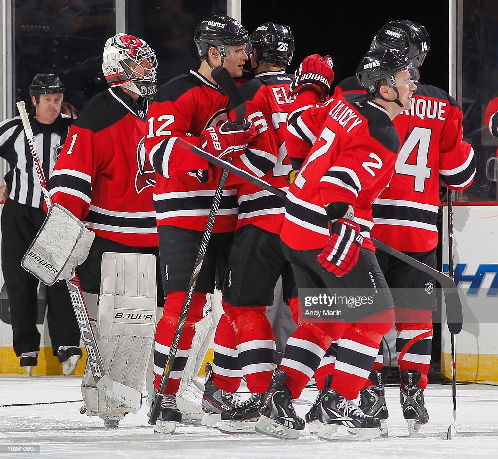 Johan Hedberg #1 of the New Jersey Devils is congratulated by his teammates after defeating the Buffalo Sabres at the Prudential Center on March 7, 2013 in Newark, New Jersey. The Devils defeated the Sabres 3-2 in a shootout.