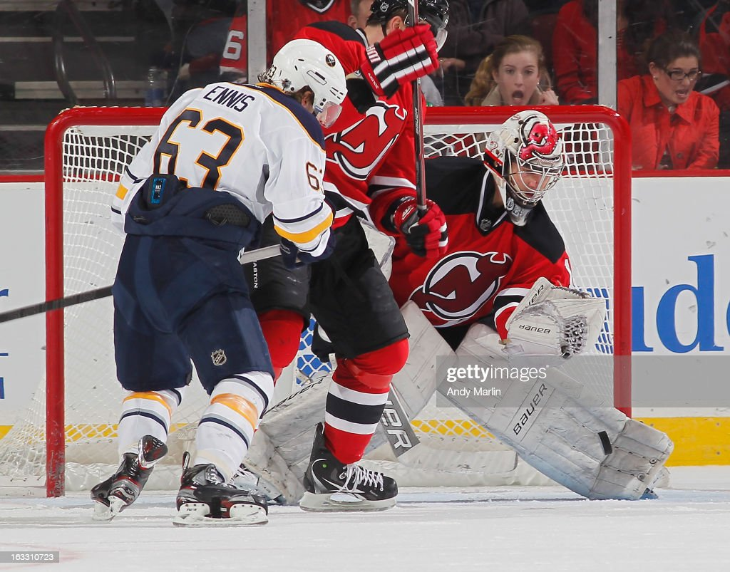 Johan Hedberg #1 of the New Jersey Devils makes a pad save as Tyler Ennis #63 of the Buffalo Sabres looks for a rebound during the game at the Prudential Center on March 7, 2013 in Newark, New Jersey.