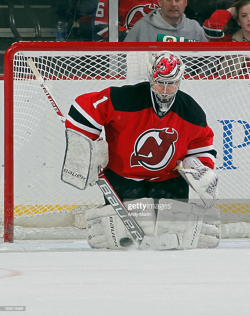 Johan Hedberg #1 of the New Jersey Devils makes a save against the Buffalo Sabres during the game at the Prudential Center on March 7, 2013 in Newark, New Jersey.
