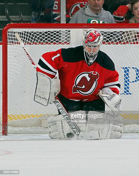 Johan Hedberg of the New Jersey Devils makes a save against the Buffalo Sabres during the game at the Prudential Center on March 7 2013 in Newark New...