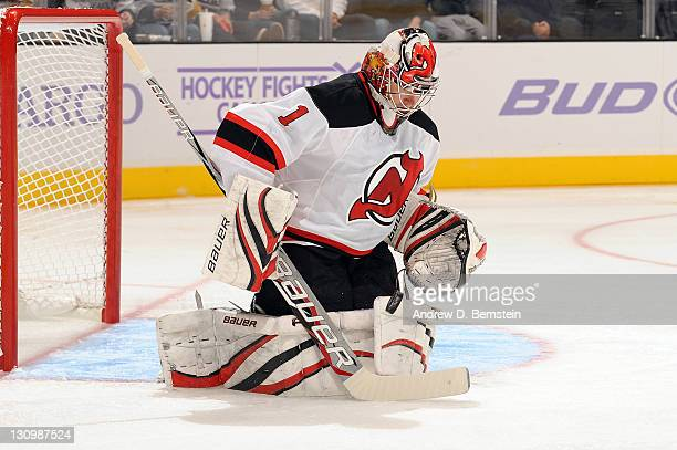 Johan Hedberg of the New Jersey Devils makes the save against the Los Angeles Kings at Staples Center on October 25 2011 in Los Angeles California...